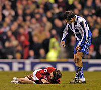 Photo. Jed Wee.<br /> Manchester United v FC Porto, UEFA Champions League, Old Trafford, Manchester. 09/03/2004.<br /> Manchester United's Christiano Ronaldo goes down injured only minutes after coming onto the pitch, as Porto's Nuno Valente displays his concern.