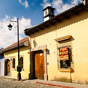 Houses on one of the cobblestone streets in Antigua, Guatemala.