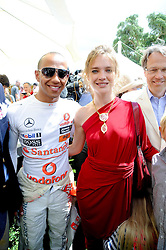 LEWIS HAMILTON and NATALIA VODIANOVA at a luncheon hosted by Cartier for their sponsorship of the Style et Luxe part of the Goodwood Festival of Speed at Goodwood House, West Sussex on 4th July 2010.