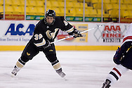 October 13, 2007 - Anchorage, Alaska:  Jeremy Tejchma (39) of the Wayne State Warriors sets up for a slap shot in the 1-4 loss to Robert Morris in the 3rd game of the Nye Frontier Classic at the Sullivan Arena.  RMU would go on to be the Classic Champions after host Alaska-Anchorage tied with Boston University in the 4th game of the Classic.