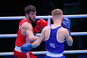Hamsat Shadalov of Germany (red) and Kurt Walker of Ireland (bue) competing in the Men's Featherweight preliminaries during The Road to Tokyo European Olympic Boxing Qualification, Sunday, March 15, 2020, in London, United Kingdom. (Mitchell Gunn-ESPA-Images/Image of Sport)