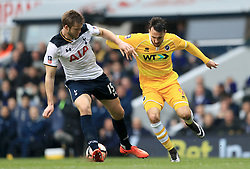 Tottenham Hotspur's Eric Dier (left) and Millwall's Lee Gregory (right) battle for the ball