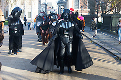 ©Licensed to London News Pictures 15/12/2019. <br /> Greenwich ,UK. Darth Vader helping out. The Pantomime Christmas horse race around Greenwich pubs in South East London took place this afternoon. Now in its 10th year the race had a Star Wars theme. Photo credit: Grant Falvey/LNP