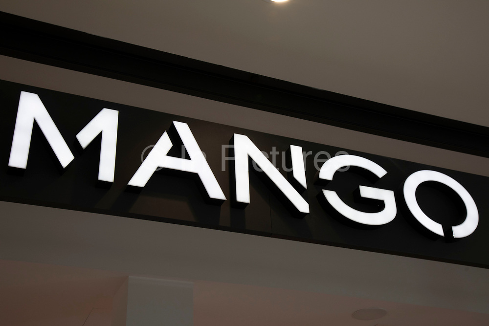 Sign for the high street clothing brand Mango in Birmingham, United Kingdom.