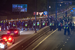 © Licensed to London News Pictures. 03/04/2021. Bristol, UK. Police form a line to stop protesters as they walk on the M32 during the 'Kill the Bill' demonstration in Bristol. Crowds gathered to protest against the proposed Police, Crime, Sentencing and Courts Bill. Photo credit: Peter Manning/LNP