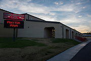 """The marquee reads """"Pray for Iraan"""" outside of Iraan High School in Iraan, Texas on December 13, 2016. (Cooper Neill for The New York Times)"""