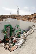 Greece, Syros, Cyclades: A nice house near the wind turbines.