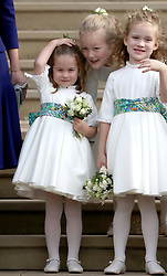 Princess Charlotte waves to Princess Eugenie and her new husband Jack Brooksbank as they leave St George's Chapel in Windsor Castle following their wedding.
