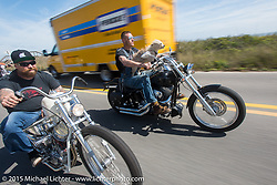 "Bill Dodge riding his custom 1952 Harley-Davidson (John Green) Panhead beside ""Moonshiner Josh"" and ""Cutie Pie"" of the Moonshiners reality show south of Flagler Beach during Daytona Beach Bike Week 2015. FL, USA. March 13, 2015. Photography ©2015 Michael Lichter."