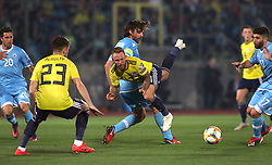 Scotland's Johnny Russell (centre) is tackled during the UEFA Euro 2020 Qualifying, Group I match at the San Marino Stadium, Serravalle.
