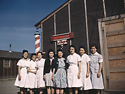 Japanese-American camp, Tule Lake Relocation Center, California 1942/1943. Eight Japanese women standing outside the barber's shop in the US war emergency evacuation camp set up in World War II.  Internment Alien