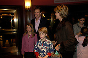 the hon James and Mrs. Ogilvy with Flora and Alexander. Mary Poppins Gala charity night  in aid of Over the Wall. Prince Edward Theatre. 14 December 2004. ONE TIME USE ONLY - DO NOT ARCHIVE  © Copyright Photograph by Dafydd Jones 66 Stockwell Park Rd. London SW9 0DA Tel 020 7733 0108 www.dafjones.com