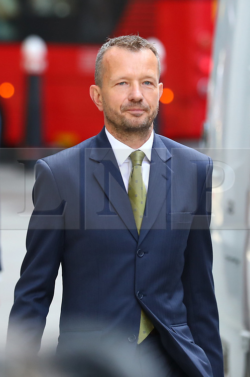 © Licensed to London News Pictures. 18/07/2018. London, UK. BBC journalist Dan Johnson arrives at the Rolls Building of the High Court in London where judges will deliver their decision on Sir Cliff Richard's claim for damages against the BBC for loss of earnings. The 77-year-old singer is suing the corporation after his home in Sunningdale, Berkshire was raided following allegations of sexual assault made to Metropolitan Police. Photo credit: Rob Pinney/LNP
