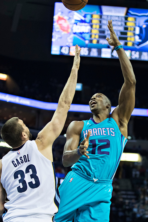 MEMPHIS, TN - OCTOBER 30:  Dwight Howard #12 of the Charlotte Hornets shoots a hook shot over Marc Gasol #33 of the Memphis Grizzlies at the FedEx Forum on October 30, 2017 in Memphis, Tennessee.  NOTE TO USER: User expressly acknowledges and agrees that, by downloading and or using this photograph, User is consenting to the terms and conditions of the Getty Images License Agreement.  The Hornets defeated the Grizzlies 104-99.  (Photo by Wesley Hitt/Getty Images) *** Local Caption *** Dwight Howard; Marc Gasol