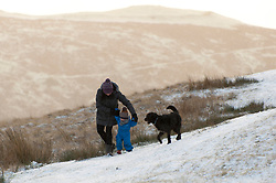 © Licensed to London News Pictures. 28/01/2020. Howey, Powys, Wales, UK. A woman child and dog are seen in a wintry landscape near Howey in Powys, Wales, UK. Photo credit: Graham M. Lawrence/LNP