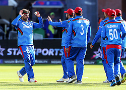 Afghanistan's Hamid Hassan catches New Zealand's Colin Munro and celebrates with team mates during the ICC Cricket World Cup group stage match at the County Ground Taunton.