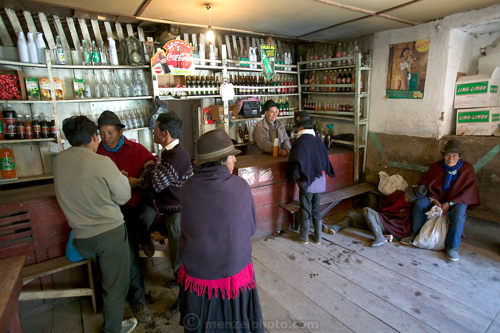 One of the bars in Simiatug, Ecuador, on market day. Taking advantage of their visit to town, men (and a few women) throng the taverns, to drink Andean beer and local hard liquor. (Supporting image from the project Hungry Planet: What the World Eats.)