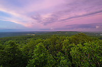 A colorful pink sunset fills the sky on the evening of Summer Solstice. This scenic view is from the top of Blue Mound, the highest point in southern Wisconsin.