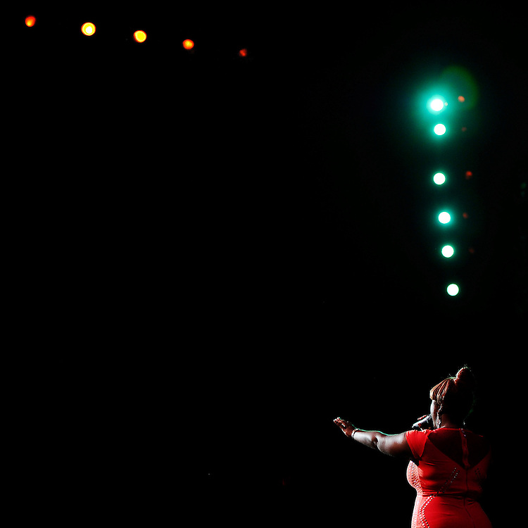 Nekita Waller reaches out toward the audience during a performance at the Warner Theater.