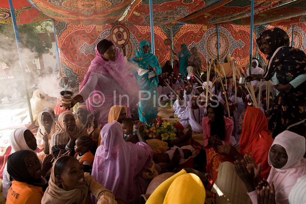 Ladies attending the first-ever international Conference on Womens' Challenge in Darfur, gather to dance and sing traditional songs in a compound belonging to the Governor of North Darfur in Al Fasher (also spelled, Al-Fashir) where the women from remote parts of Sudan gathered to discuss peace and political issues. The Sudanese Women General Union has 27,000 branches all over Sudan, including Darfur. They have representatives in all rural villages, across communities of around 80 tribes and clans. The women of Sudan are wives, mothers, farmers a real force and historically, there have been female leaders.