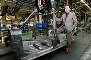 British auto executive Paul Stowe stands by the body of a Taxi cab in SMA factory plant, in Fengjing, outside Shanghai, China, on October 24, 2008. Stowe oversees SMA, the joint venture between Britain's Manganese Bronze Holdings PLC, owner of London Taxi International, and Geely Group Holdings, one of China's biggest independent automakers, that will produce London Taxi's famed black cabs in China. London Taxi International, the original producer of the cabs, turned to China to drive overseas expansion. More than 8,000 London Taxis will be produced from the Chinese factory, more than double the annual output of the firm's historical factory plant in Conventry, England. Most of these cars will go to places like Singapore, Dubai, Moscow, that covet the image associated with the London Taxis' tradition of good service and durability. London Taxi International will continue to build 90 percent of the Taxi cabs used in Britain at Coventry. Photo by Lucas Schifres/Pictobank