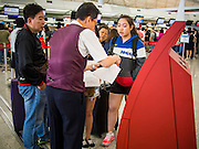 14 AUGUST 2013 - HONG KONG: An airline official briefs passengers on their delay because of Severe Typhoon Utor at Hong Kong International Airport. Dozens of flights were delayed at one of the busiest airports in Asia and Hong Kong raised their alert to level 8, the highest, and closed schools and many businesses because of Severe Typhoon Utor. The storm passed within 260 kilometers of Hong Kong before making landfall in mainland China. Severe Typhoon Utor (known in the Philippines as Typhoon Labuyo) is an active tropical cyclone located over the South China Sea. The eleventh named storm and second typhoon of the 2013 typhoon season, Utor formed from a tropical depression on August 8. The depression was upgraded to Tropical Storm Utor the following day, and to typhoon intensity just a few hours afterwards. The Philippines, which bore the brunt of the storm, reported 1 dead in a mudslide and 23 fishermen missing at sea.   PHOTO BY JACK KURTZ