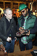 l to r: Daniel Powers(Powerhouse Books) and Coltrane Curtis at The Timberland New Store Opening in Soho featuring a Powerhouse Books Exhibition, ' Nature of a City ' featuring NY based Photographers Janette Beckman, Vivian Cherry, Martha Cooper, Arlene Gottfried, Lisa Kahane, Maripol, Ricky Powell and Jamel Shabazz held at The Timberland Store in New York City on March 27, 2009..The exhibit, entitled Nature of a City, features images from the powerHouse archives that capture the energy and vitality of a city that - like Timberland - is constantly evolving, creating and defying trends. For the exhibit, powerHouse and Timberland selected photos from New York-based photographers Janette Beckman, Vivian Cherry, Martha Cooper, Arlene Gottfried, Lisa Kahane, Maripol, Ricky Powell and Jamel Shabazz.