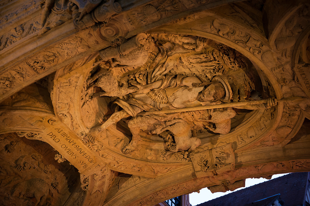 A carving of the Good Shephered in the arch of the Gros Horloge (Great Clock) in the heart of Rouen, France.