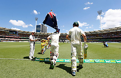 Australia's Cameron Bancroft and David Warner take the field during day two of the Ashes Test match at The Gabba, Brisbane.