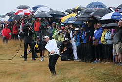 Northern Ireland's Rory McIlroy chips from the rough on the 15th during day two of The Open Championship 2018 at Carnoustie Golf Links, Angus.