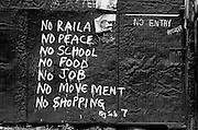 NAIROBI, KENYA - DECEMBER 31, 2007: Graffiti by revered street artist Solo 7 adorns a shop in Kibera slum following the disputed 2007 presidential election. A surge in violence left scores of people dead in Nairobi as defeated presidential candidate Raila Odinga prepared to declare himself head of state, after rejecting the victory of incumbent president Mwai Kibaki.