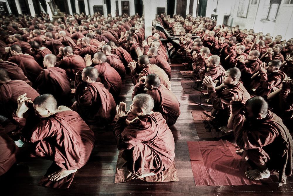Bago (Pago), Myanmar (Burma) May 2006<br /> Buddhist monks read in a monastery of Bago.<br /> Photo: Ezequiel Scagnetti