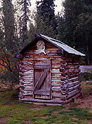Log outhouse by trapper cabin at the Anvik River Lodge northwest of Anvik, Alaska.