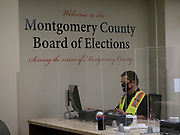 A Montgomery County Board of Elections official reviews voter registration data as early voting gets underway in Ohio.