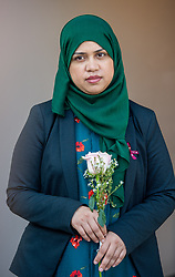 Tafida Raqeeb's mother, Shelina Begum, holds a rose given to her by a local police officer after a press conference at the Gaslini Hospital in Genoa. Five-year-old Tafida's parents won a High Court battle with hospital bosses earlier this month, when a judge ruled the youngster could be moved to the Italian hospital.