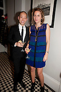 JASON WU; CHRISTINE AL-BADER, Party hosted for Jason Wu by Plum Sykes and Christine Al-Bader. Ladbroke Grove. London. 22 March 2011. -DO NOT ARCHIVE-© Copyright Photograph by Dafydd Jones. 248 Clapham Rd. London SW9 0PZ. Tel 0207 820 0771. www.dafjones.com.