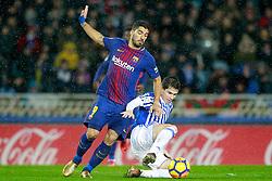 Real Sociedad's Igor Zubeldia (r) and FC Barcelona's Luis Suarez during La Liga Real Sociedad v FC Barcelona match in San Sebastian-Donostia, Spain, January 14, 2018. Photo by Acero/AlterPhotos/ABACAPRESS.COM