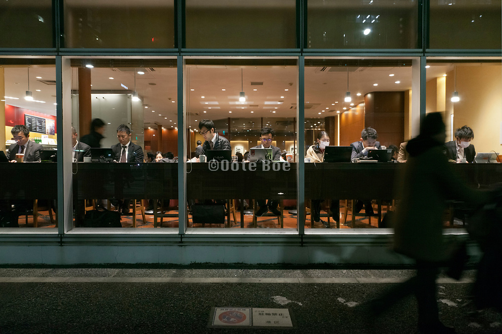 business people working at night in coffee bar Tokyo Japan