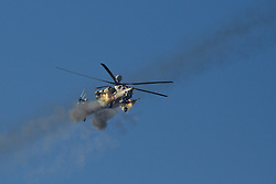 Licensed to London News Pictures. 20/02/2017. Albu Saif, Iraq. An Iraqi Army Aviation Mi-28 attack helicopter fires unguided rockets and 30mm canon into the village of Albu Saif as Iraqi security forces continue with the offensive to retake western Mosul from Islamic State forces.<br /> <br /> The settlement of Albu Saif is located on high ground overlooking Mosul Airport and as such is a strategic point that needs to be taken as part of the operation to retake the western side of Mosul. Photo credit: Matt Cetti-Roberts/LNP