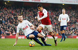Arsenal's Alexis Sanchez, right is tackled by Tottenham Hotspur's Eric Dier