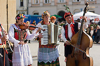 Folk musicians playing in the Market sqaure Rynek glowny in Krakow Poland