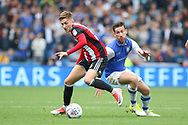 Sheffield United midfielder David Brooks (36) battles with Sheffield Wednesday midfielder David Jones (3)  during the EFL Sky Bet Championship match between Sheffield Wednesday and Sheffield Utd at Hillsborough, Sheffield, England on 24 September 2017. Photo by Phil Duncan.