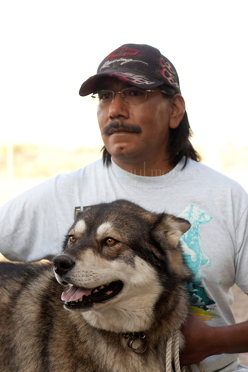 """MCDERMITT, NV - AUG 17  """"Denala""""  is held by his owner Vincent Dave during a clinic sponsored by the Humane Society of the United States August 17, 2009 in McDermitt Nevada.  (Photograph by David Paul Morris)"""