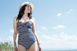 Mature woman walking in swimsuit at the lake, Bavaria, Germany