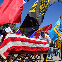 072415       Cable Hoover<br /> <br /> Fellow Code Talker Thomas Begay, right, salutes as members of the American Legion lay an American flag over the casket of Navajo Code Talker Kee Etsicitty during a funeral ceremony at Sacred Heart Cathedral in Gallup Friday.
