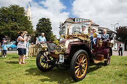 Datchet, UK. 30 June, 2019. A pre-1905 vehicle taking part in the 48-mile Ellis Journey from Micheldever station near Winchester arrives at the destination in Datchet. The Ellis Journey is a reenactment of the first recorded journey by a motorised carriage in England undertaken by pioneer automobilist Hon. Evelyn Ellis in his new, custom-built Panhard-Levassor on 5th July 1895. The original journey took place in contravention of the law because the Panhard exceeded a speed of 4mph and was not preceded by an attendant walking with a red flag.
