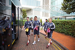 CARDIFF, WALES - Tuesday, October 7, 2014: Wales' Tom Lawrence, Emyr Huws and George Williams depart the team hotel for a training session at Dragon Park National Football Development Centre ahead of the UEFA Euro 2016 qualifying match against Bosnia and Herzegovina. (Pic by David Rawcliffe/Propaganda)