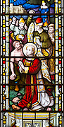 Stained glass window East Bergholt church, Suffolk, England, UK, five tiers of biblical scenes c 1865 by Lavers, Barraud and Westlake detail of mob stoning