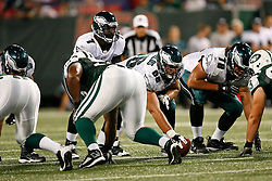 Philadelphia Eagles quarterback Michael Vick #7 receives a snap from center Dallas Reynolds #66 during the NFL game between the Philadelphia Eagles and the New York Jets on September 3rd 2009. The Jets won 38-27 at Giants Stadium in East Rutherford, NJ.  (Photo By Brian Garfinkel)