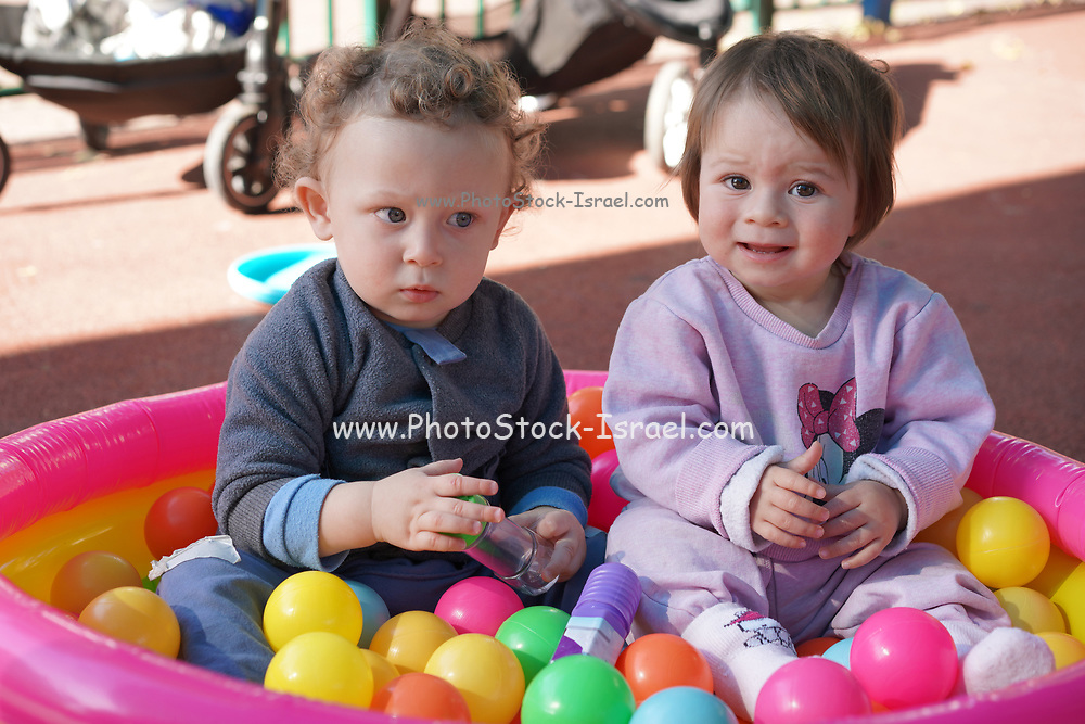 Young playful toddler boy with a friend